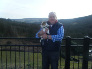 Paul. Owner of OneNetBiz pictured in the Peak District with his Jack Russell terrier