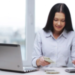 Image of girl counting earnings from online sales