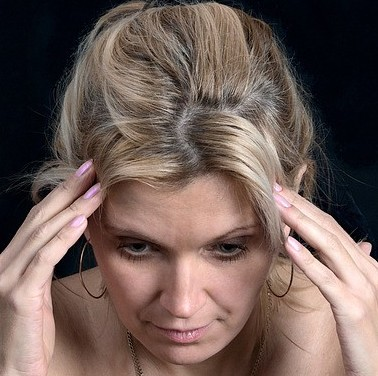 Woman with head pain.