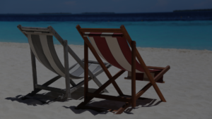 image of two deck chairs on the beach