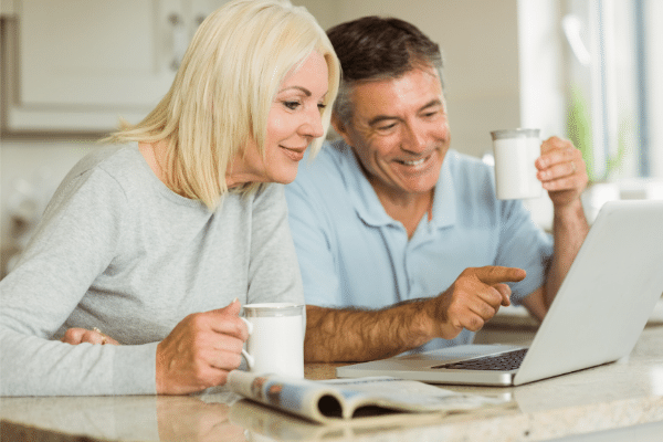 mature couple looking at a laptop computer