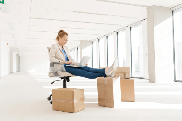 what is the best business to start now? Woman sat on boxes in a new office starting a new business